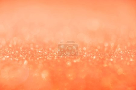 abstract orange background with shiny glitter