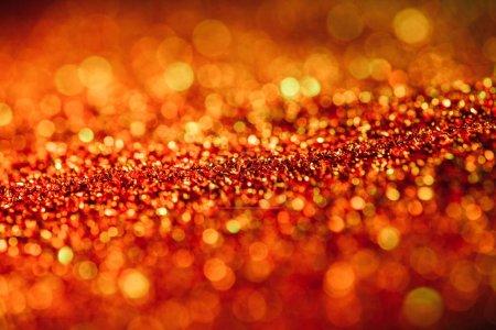 abstrait fond brillant avec des paillettes rouges déconcentrées