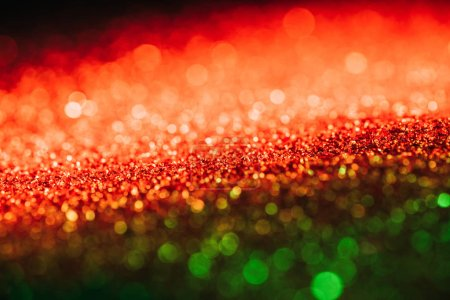 glowing christmas texture with red and green blurred glitter