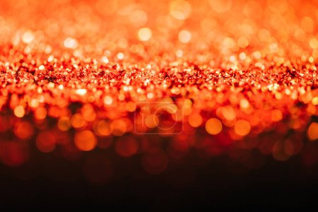 glowing christmas texture with red defocused glitter