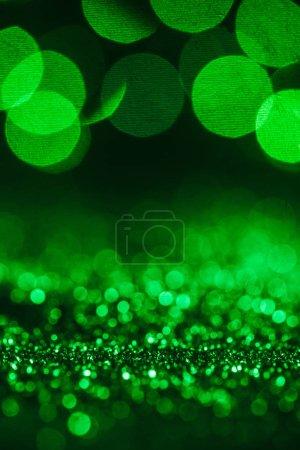 fond abstrait de Noël avec des paillettes vertes et bokeh