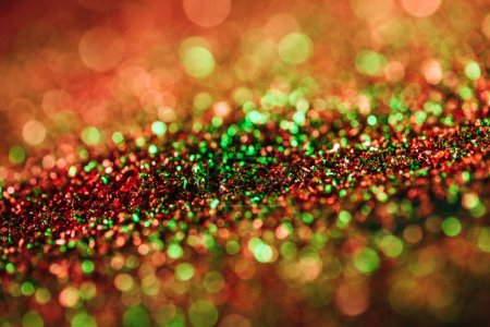 glowing christmas texture with colorful blurred glitter