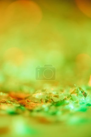 abstract shiny background with orange and green glitter