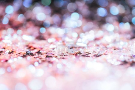 shiny background with light pink glitter and bokeh
