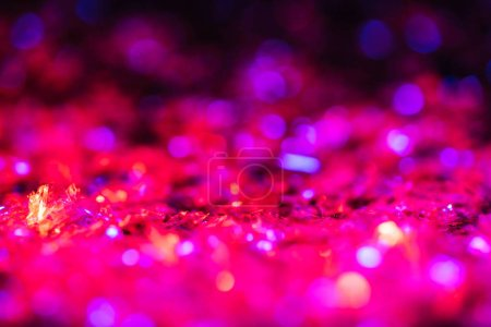 sparking texture with bright pink glitter and bokeh