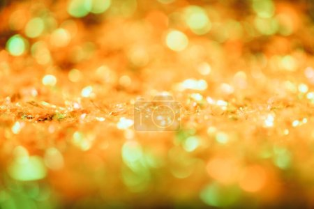abstract christmas background with orange defocused glitter