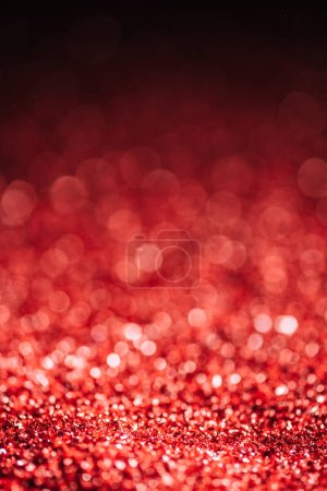 abstract christmas background with red defocused glitter