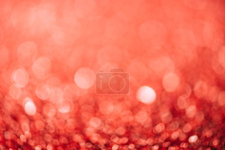 abstract red christmas background with blurred glitter