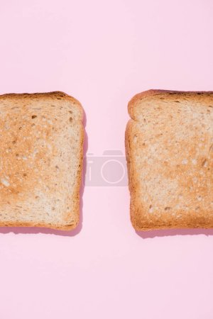 top view of roasted toasts on pink surface