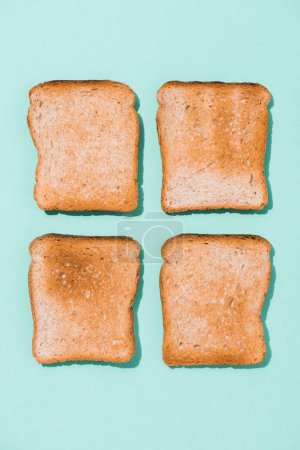 top view of assembled crunchy toasts on blue surface