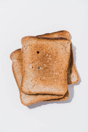 top view of stacked toasts on white surface