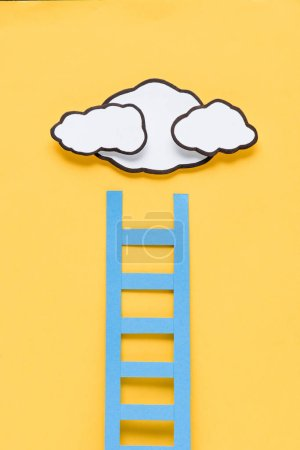 Photo for Top view of paper ladder with clouds on yellow background, setting goals concept - Royalty Free Image