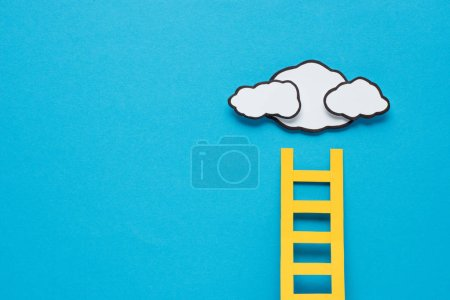 Photo for Paper ladder with clouds and copy space on background, setting goals concept - Royalty Free Image