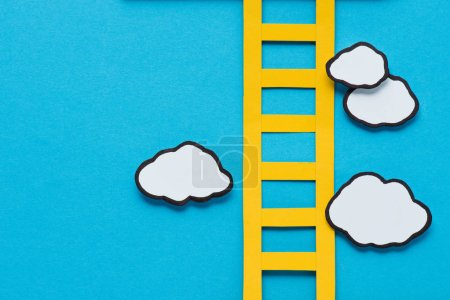 Photo for Top view of paper ladder with clouds on blue background, setting goals concept - Royalty Free Image