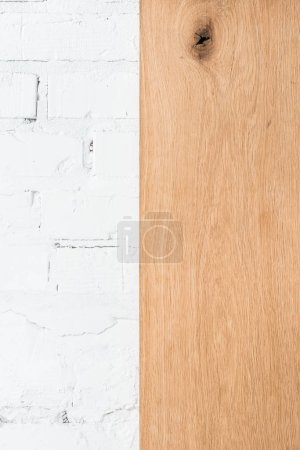 white brick wall and wooden surface