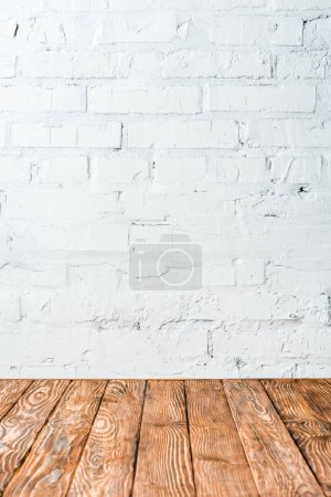 white brick wall and wooden table