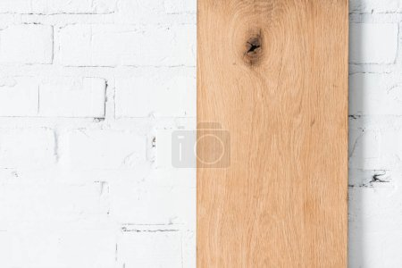 white brick wall and rustic wooden board