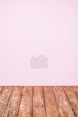 Photo for Pink wall and rustic wooden table - Royalty Free Image