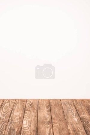 beige wall and rustic wooden table