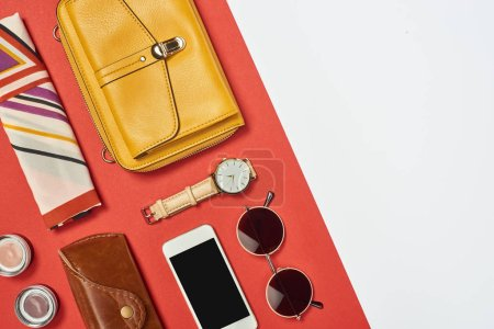 Photo for Top view of  yellow bag, sunglasses, smartphone, watch, case, scarf and eyeshadow - Royalty Free Image