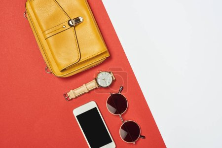 Photo for Top view of  yellow bag, sunglasses, smartphone, watch with copy space - Royalty Free Image