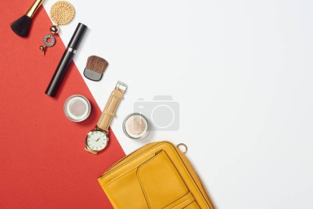 Photo for Flat lay with mascara, watch, bag, eyeshadow, cosmetic brushes and earring - Royalty Free Image