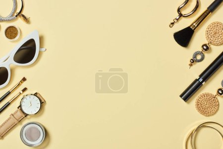 Photo for Top view of watches, sunglasses, eyeshadow, cosmetic brushes, bracelets, earrings and mascara - Royalty Free Image