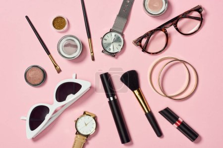 Photo for Top view of watches, lipstick, glasses, sunglasses, eyeshadow, blush, cosmetic brushes, bracelets and mascara - Royalty Free Image