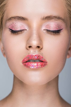 attractive woman with glittering makeup with closed eyes
