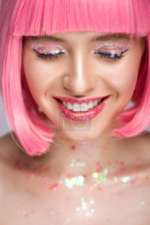 smiling attractive woman with pink hair and glitter on face
