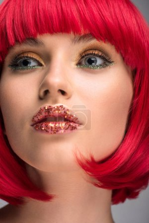 Photo for Attractive woman with red hair and glitter on lips looking away - Royalty Free Image