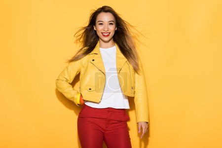 Photo for Young asian female model posing on yellow background - Royalty Free Image