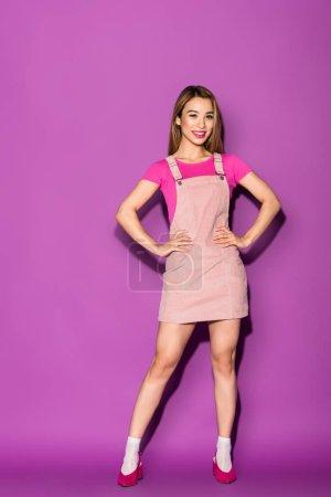stylish asian female model posing on purple background