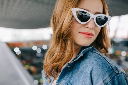 Photo for Portrait of smiling fashionable woman in denim clothing and retro sunglasses - Royalty Free Image