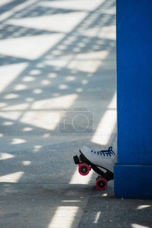 Photo for Single white vintage roller skate on street - Royalty Free Image