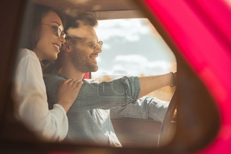 Photo for Beautiful happy couple driving car together - Royalty Free Image