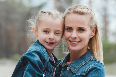 Photo for Beautiful smiling blonde mom and daughter - Royalty Free Image