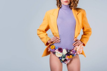 cropped shot of girl in panties made of flowers standing with hands on waist isolated on grey