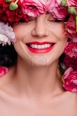 beautiful young woman in floral wreath smiling with closed eyes