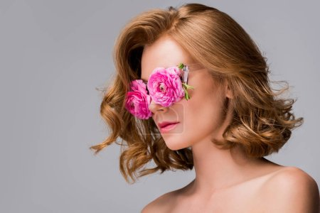 young naked woman wearing glasses with flowers isolated on grey