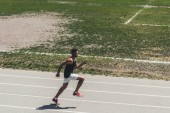 high angle view of male sprinter on running track at sport playground