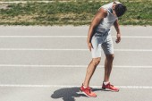 young sporty runner receive leg injury during jogging