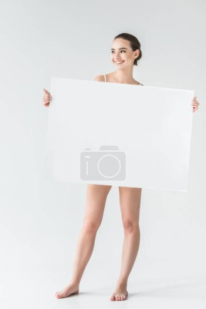 happy young woman holding blank banner isolated on gray background