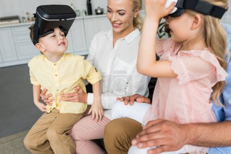 Photo for Cropped shot of parents playing with kids using virtual reality headsets at home - Royalty Free Image