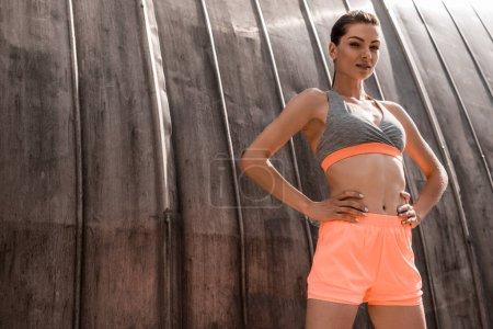 beautiful athletic woman posing in sportswear