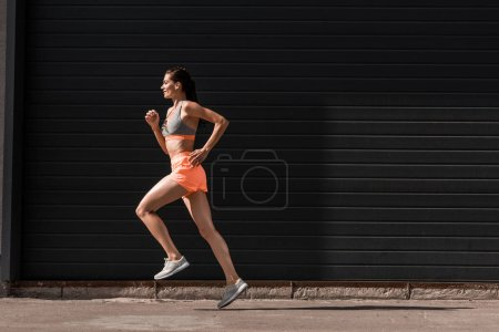young attractive female runner training in sportswear