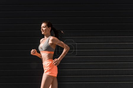 Photo for Young beautiful sportive girl jogging in sportswear - Royalty Free Image