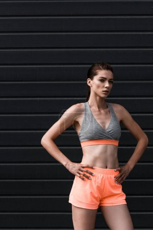 young attractive athletic woman posing in sportswear