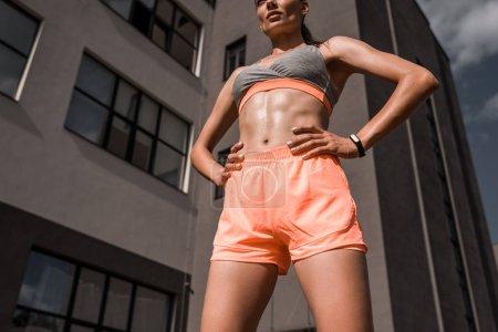 bottom view of athletic woman posing in sportswear