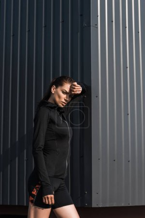 young sportswoman in black thermal clothes